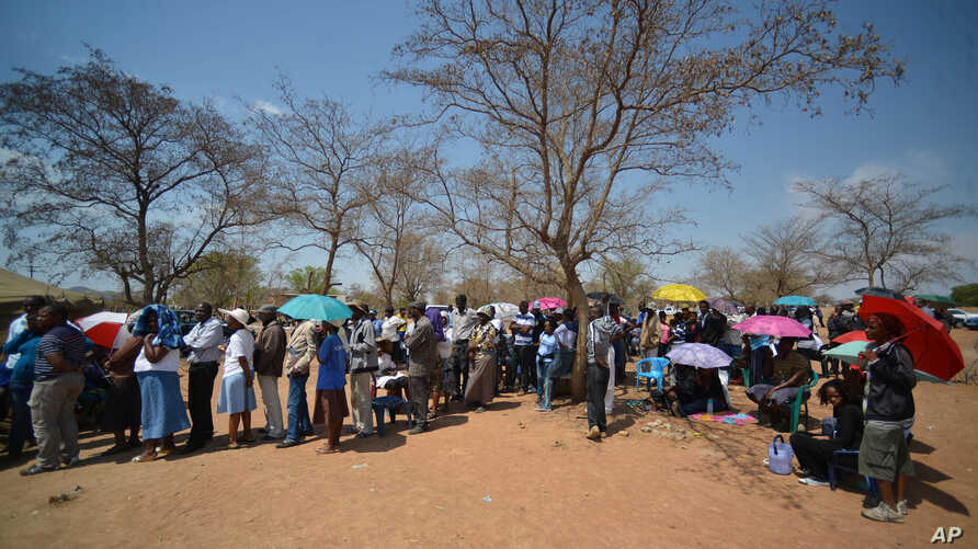 Voters queue to cast their votes at a polling station in Gaberone, Botswana, Oct. 24, 2014.