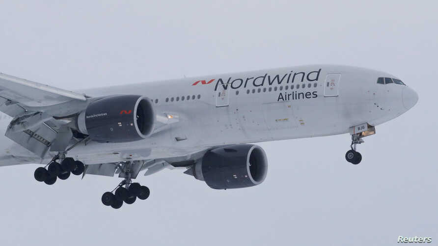A 777-200ER plane owned by Russia's Nordwind Airlines descends before landing and completing a direct flight from the Venezuelan capital of Caracas at Vnukovo International Airport outside Moscow, Russia Jan.31, 2019.