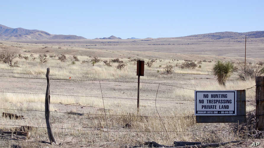 FILE- This Jan. 20, 2012, file photo, near Cloverdale in New Mexico's Bootheel region shows a gated part of the Diamond A Ranch and is 77 miles from the nearest  border patrol station. A 7-year-old Guatemalan girl died after her father and other migr