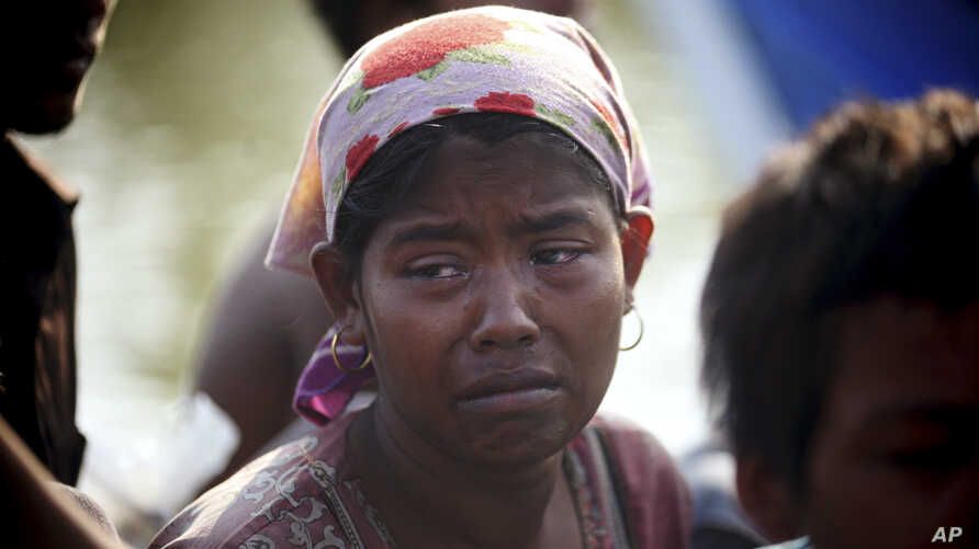 A rescued migrant weeps upon arrival in Simpang Tiga, Aceh province, Indonesia, Wednesday, May 20, 2015. Hundreds of migrants stranded at sea for months were rescued and taken to Indonesia, officials said Wednesday, the latest in a stream of Rohingya
