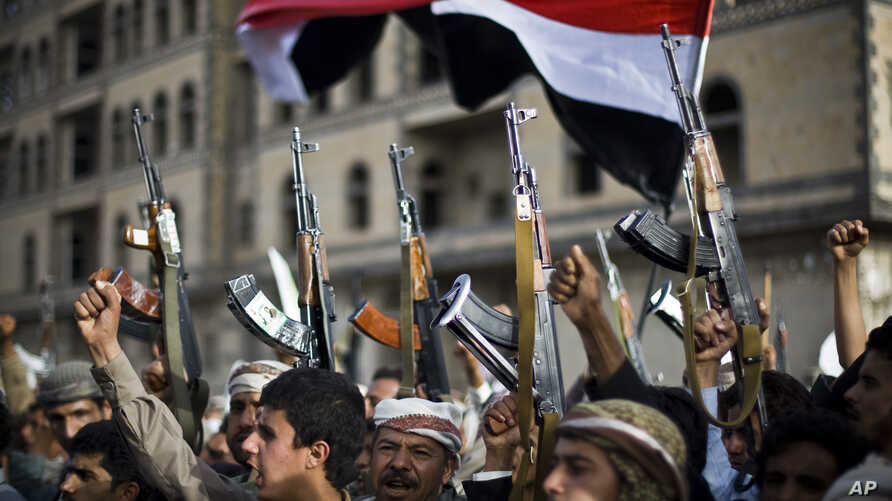 Shiite rebels, known as Houthis, hold up their weapons as they attend a protest against Saudi-led airstrikes in Sanaa, Yemen, April 10, 2015.