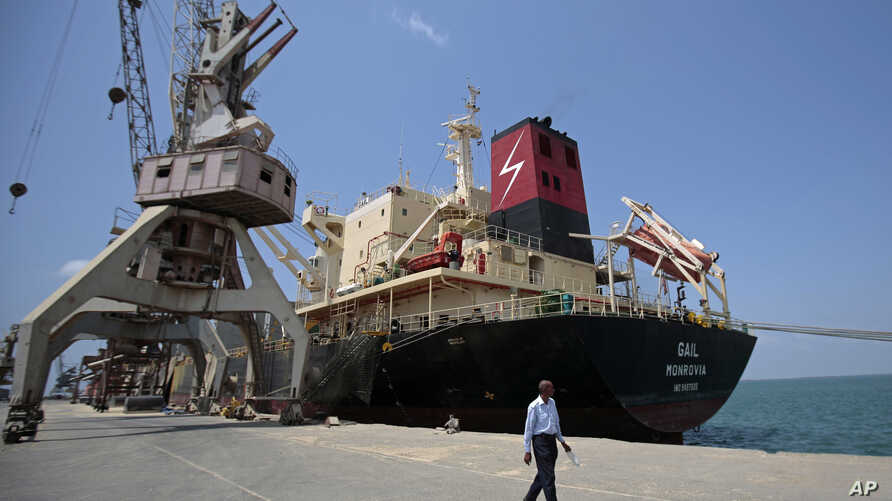 FILE - A cargo ship is docked at the Red Sea port city, of Hodeida, Yemen, Sept. 29, 2018.