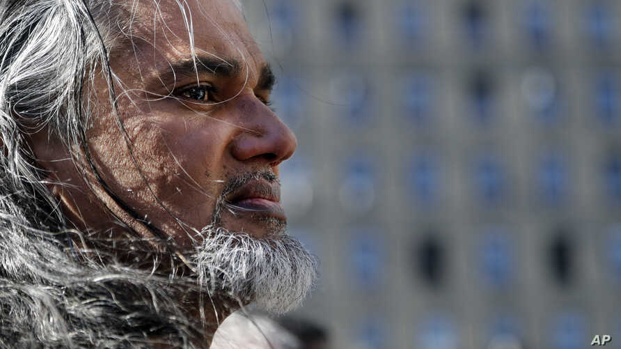 Ravi Ragbir, executive director of the New Sanctuary Coalition, arrives for his annual check-in with Immigration and Customs Enforcement, March 9, 2017, in New York. The Trinidadian immigrant works with an interfaith network of congregations and acti