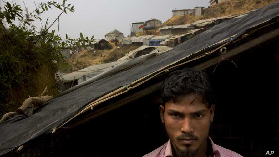 Rohingya Muslim refugee Mohammad Lalmia, 20, from the Myanmar village of Gu Dar Pyin, is pictured in Balukhali refugee camp, Bangladesh, Jan. 14, 2018. The Associated Press has confirmed more than five previously unreported mass graves in Gu Dar Pyin