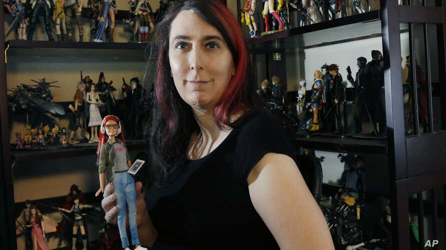 "Brianna Wu, a software engineer and video-game developer, holds a ""Game Developer Barbie"" in Boston on July 25, 2016. She has been a prime target of the online harassment campaign known as Gamergate, which subjected several women in the video-game in"
