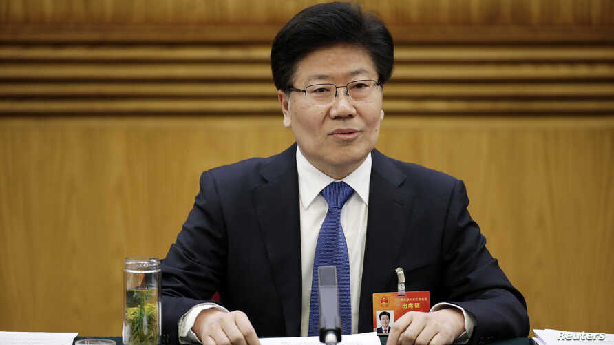Xinjiang Communist Party Secretary Zhang Chunxian answers a question during the Xinjiang delegation's group meeting at the annual session of the National People's Congress (NPC), the country's parliament, in Beijing, March 10, 2015.