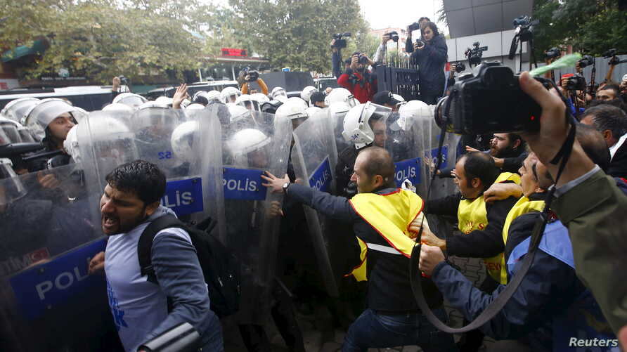Demonstrators are stopped by the police during a protest against Saturday's bombings that took place in Ankara, in Istanbul, Turkey, Oct. 13, 2015.