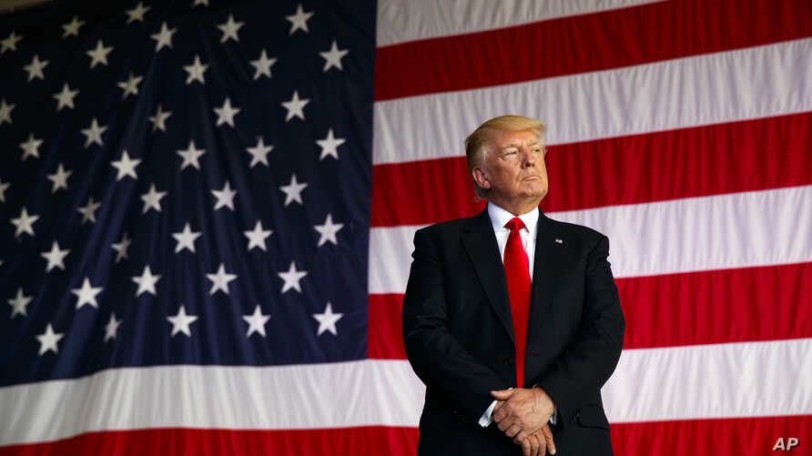 FILE - President Donald Trump is introduced to speak to U.S. military troops at Naval Air Station Sigonella, Italy.