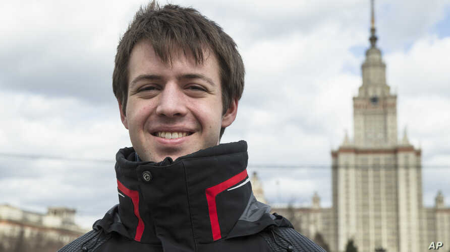 FILE - Nikolai Podchasov, a student at the Lomonosov Moscow State University, poses for a photo in front of the university during his interview with Associated Press in Moscow, Russia, April 23, 2015.