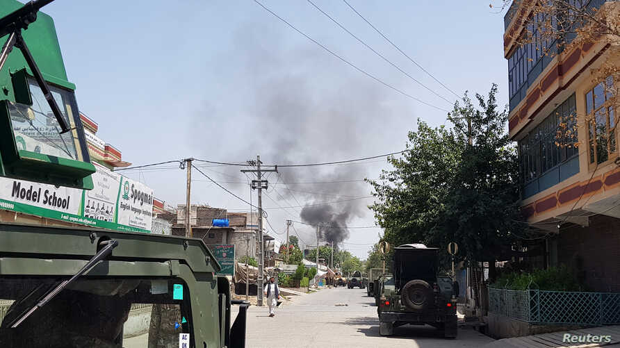 Smoke rises from an area where explosions and gunshots were heard, in Jalalabad city, Afghanistan, July 28, 2018.
