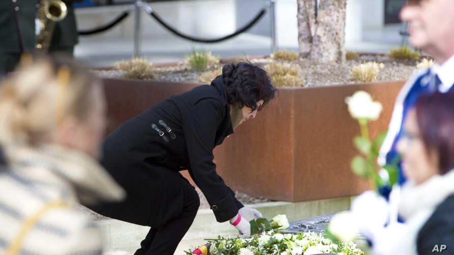 Nidhi Chaphekar, Jet Airways flight attendant and a victim of the Brussels airport terror attack, lays a rose on a memorial in Brussels, March 22, 2017. Belgian leaders, victims and families of those who died in the suicide bomb attacks on the Brusse
