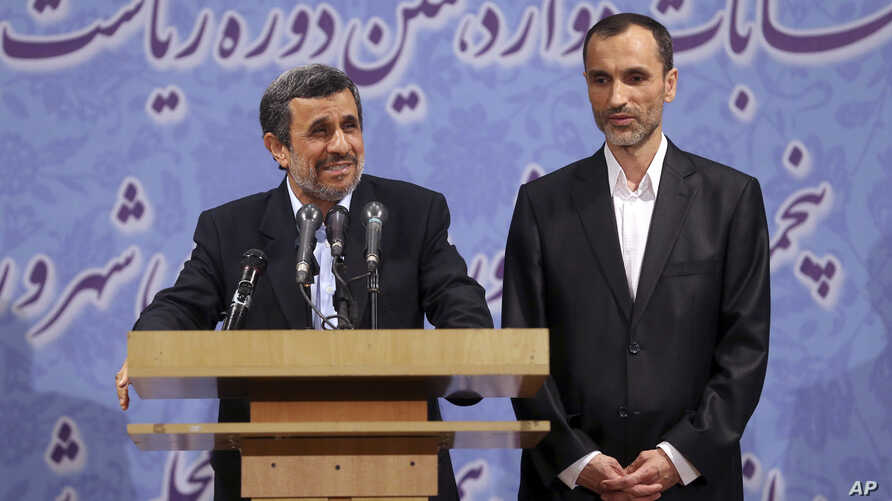 Former Iranian President Mahmoud Ahmadinejad, left, and his close ally Hamid Baghaei attend a press conference after registering his candidacy for the upcoming presidential election, at the election headquarters of the interior ministry, in Tehran, I