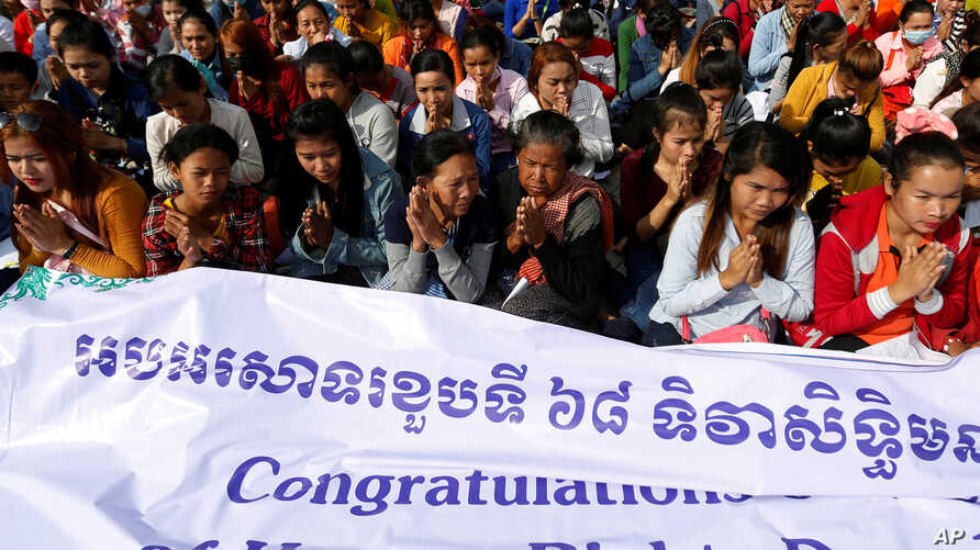People gather at Freedom Park during a Human Rights Day celebration in Phnom Penh, Cambodia, Dec. 10, 2016.