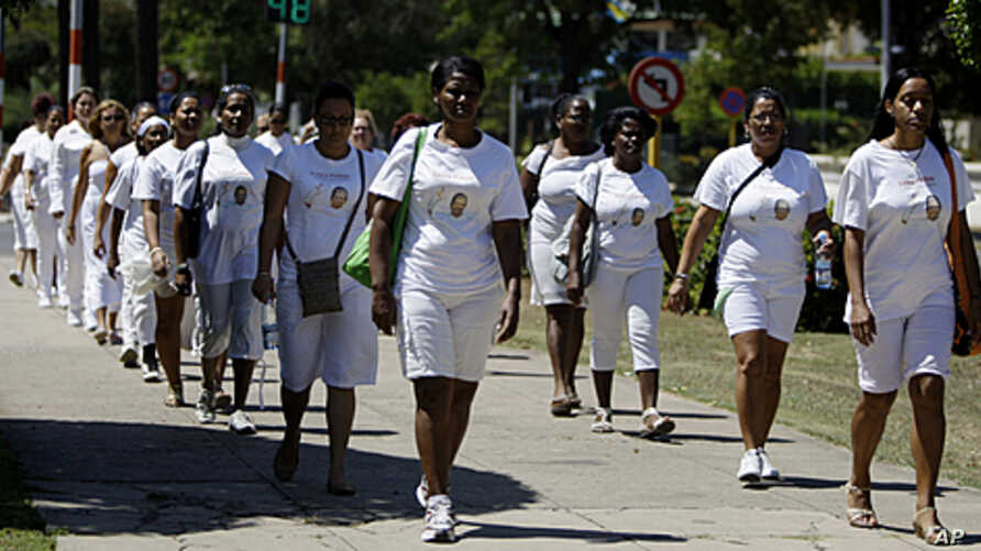 Members of dissident group Ladies in White take part in their weekly march in front of Santa Rita church in Havana, Cuba, March 18, 2012.
