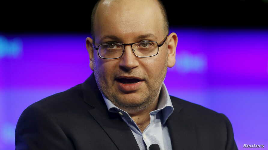 The Washington Post's Tehran bureau chief Jason Rezaian delivers remarks at the grand opening of the Washington Post newsroom in Washington, Jan. 28, 2016.