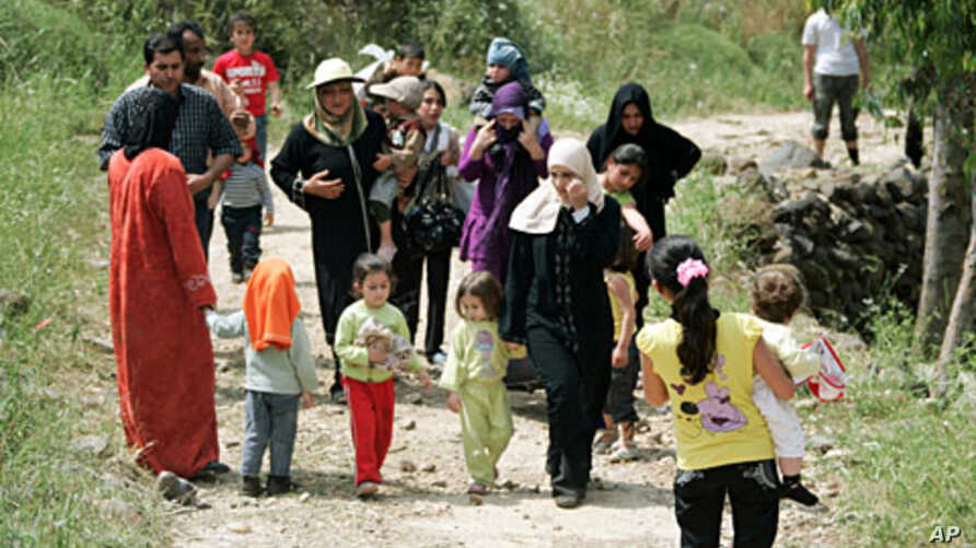 Syrian women and children arrive in Wadi Khaled in northern Lebanon, near the Lebanese-Syrian border May 16, 2011