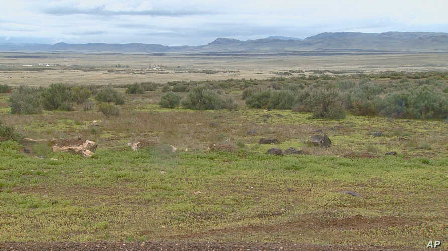 FILE - A video image courtesy of KTVB-TV shows the remote area where skeletal remains were found in a badger hole north of Mountain Home, Idaho, April 15, 2017.