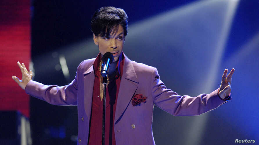 """FILE - Prince performs on the """"American Idol"""" television show finale at the Kodak Theater in Hollywood, California, May 24, 2006."""