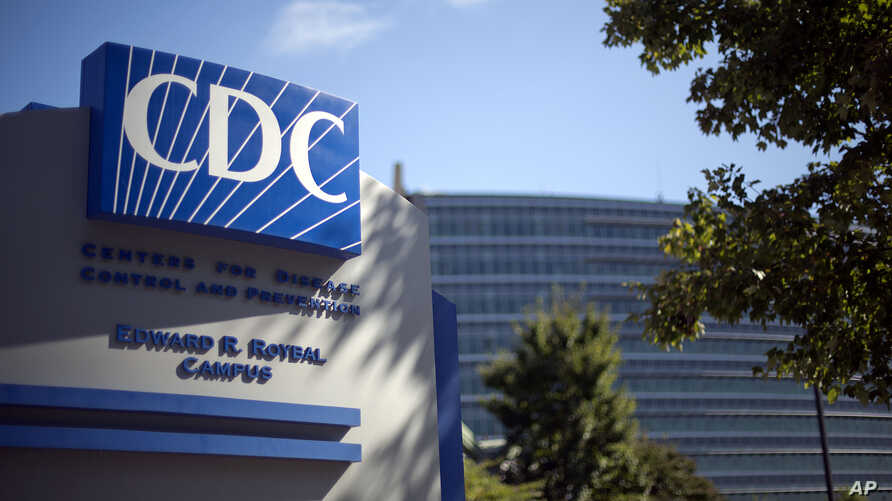 FILE - In this Oct. 8, 2013, file photo, a sign marks the entrance to the federal Centers for Disease Control and Prevention, in Atlanta, Georgia.