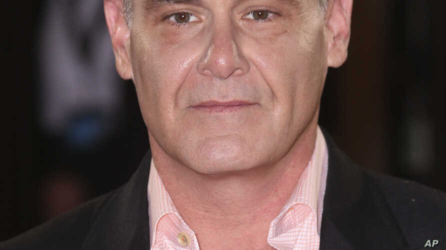 """Matthew Weiner poses for photographers upon arrival for the Premiere of """"The Romanoffs,"""" at a central London cinema, Oct 2, 2018."""