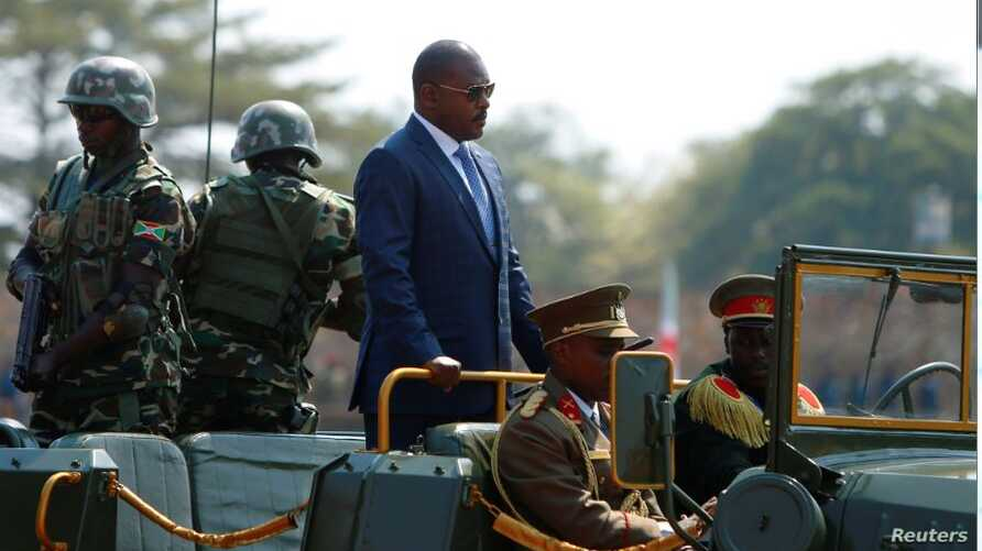 FILE - Burundi's President Pierre Nkurunziza arrives for an independence day celebration in Bujumbura, July 1, 2017. The government has suspended VOA and BBC broadcasts for six months.
