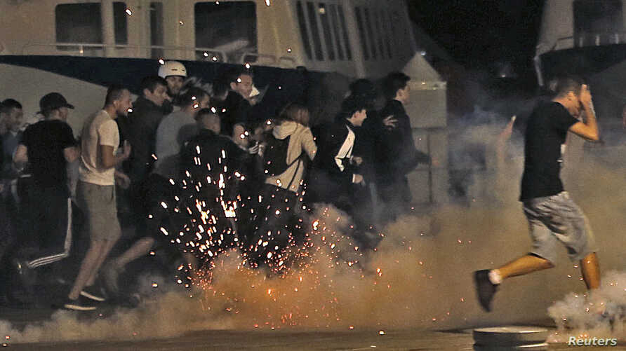 Police disperse revellers at the old port of Marseille after the England v. Russia - Group B match.