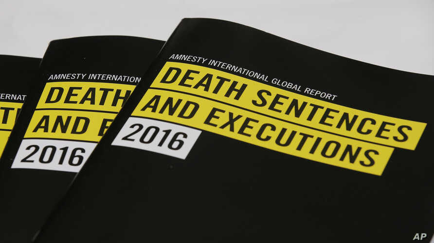 Copies of a report on the death penalty are displayed during a press conference of Amnesty International in Hong Kong, April 10, 2017.