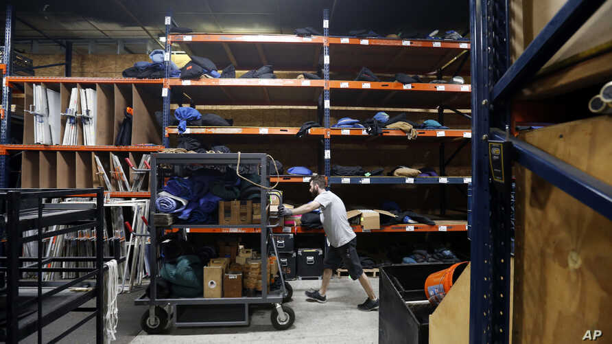 """In this  June 1, 2016 photo, a worker for MBS Equipment Co., a grip and lighting company, moves equipment in their warehouse at Second line Stages, in New Orleans. Louisiana's once-booming film industry, branded as """"Hollywood South"""", has gone from da"""