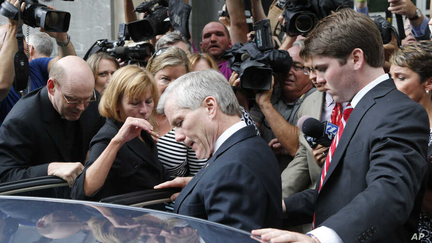 Former Virginia Gov. Bob McDonnell, center, he gets into a car with his son, Bobby, right, after McDonnell and his wife, former first lady Maureen McDonnell, were convicted on multiple counts of corruption at Federal Court in Richmond, Va., Sept. 4,