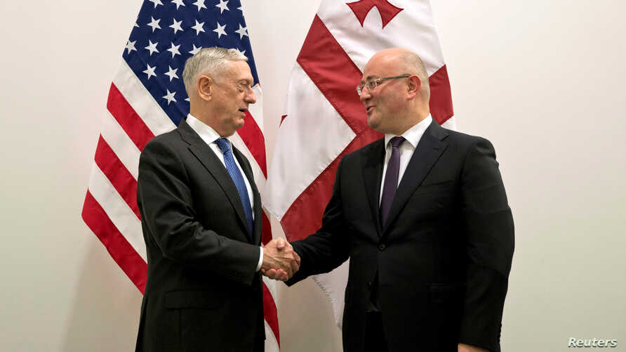 U.S. Secretary of Defense James Mattis poses with Georgia's Defense Minister Levan Izoria during a NATO defense ministers meeting at the Alliance headquarters in Brussels, Belgium, Oct. 3, 2018.