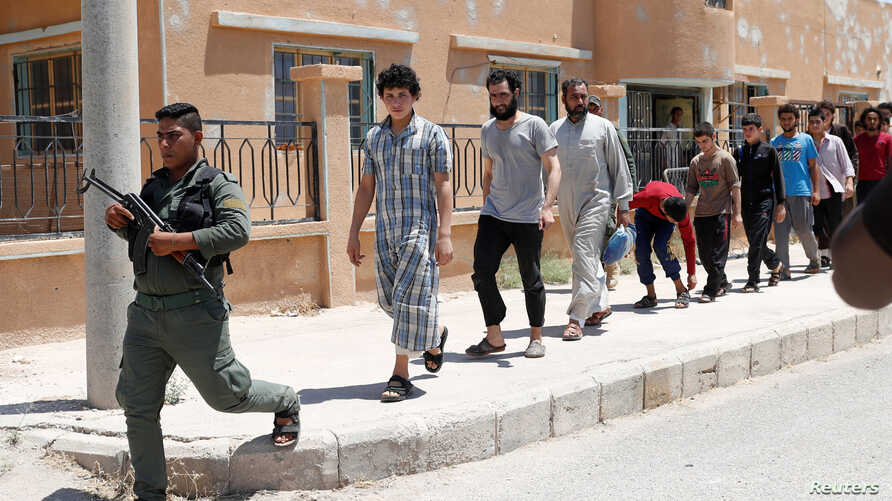 Islamic State prisoners, who were pardoned by a council that is expected to govern Raqqa once the group.