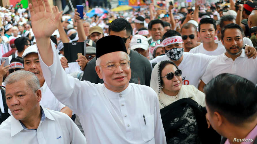 FILE - Former Malaysian Prime Minister Najib Razak and his wife, Rosmah Mansor, attend the Anti-ICERD (International Convention on the Elimination of All Forms of Racial Discrimination) mass rally in Kuala Lumpur, Malaysia, Dec. 8, 2018.