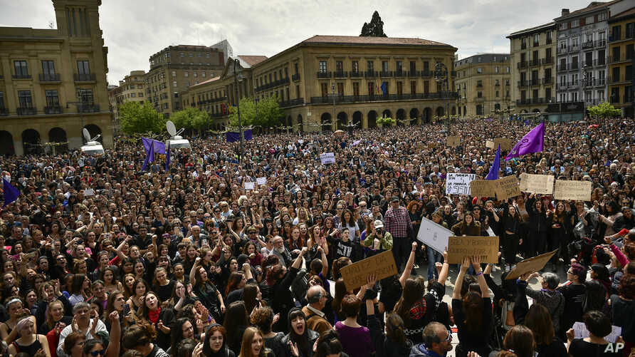 Tens of thousands of people crowd at Plaza del Castillo during a protest in Pamplona, northern Spain, April 28, 2018. A court in Pamplona sentenced five men to nine years each in prison for sexual abuse in what activists saw as a gang rape during th