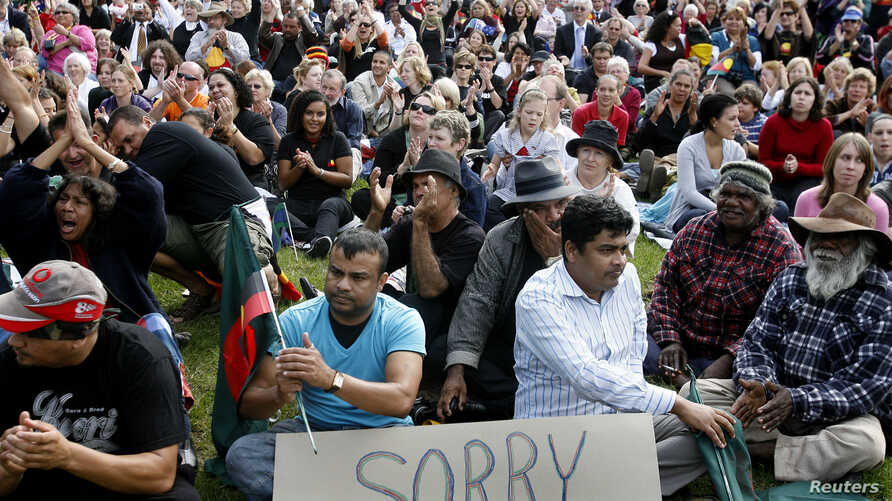 Crowds gather to watch Prime Minister Kevin Rudd apologize to Aboriginal Australians outside Parliament House in Canberra, Feb. 13, 2008. Australia apologized for the historic mistreatment of Aborigines. The Melbourne Museum has a new exhibition abou