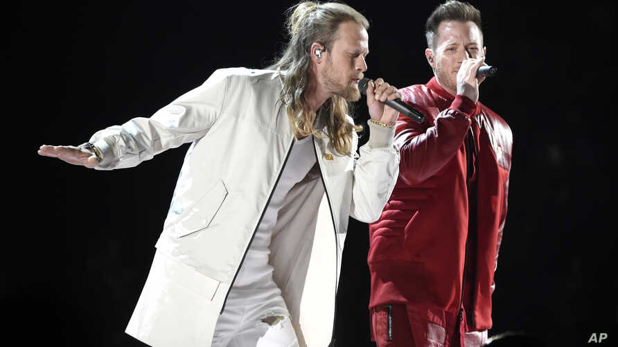 """FILE - Tyler Hubbard, right, and Brian Kelley, of Florida Georgia Line, perform """"Meant to Be"""" at the 53rd annual Academy of Country Music Awards in Las Vegas, April 15, 2018."""