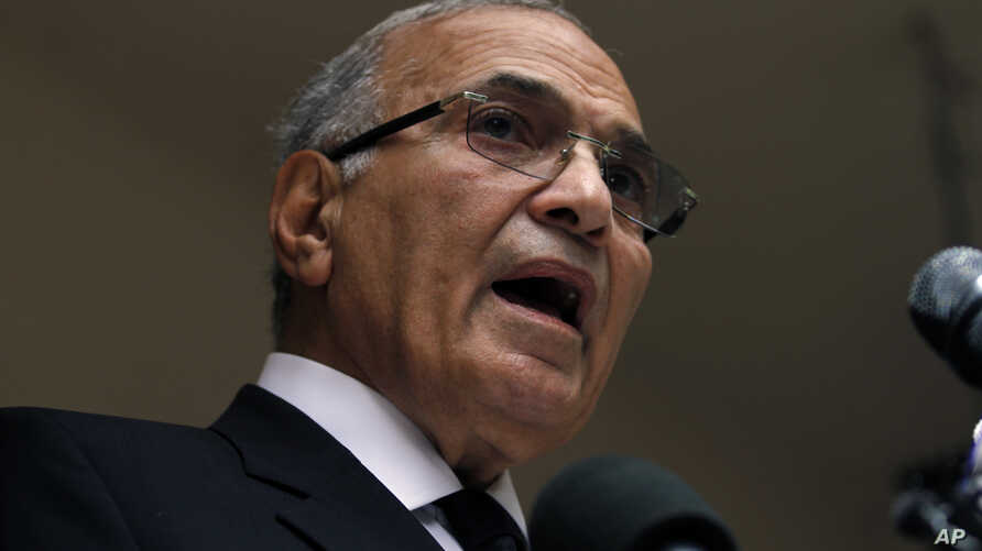 Egyptian presidential candidate Ahmed Shafiq speaks to the media during a press conference at his office in Cairo, Egypt, Saturday, May 26, 2012.