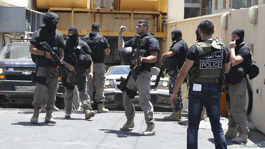 Policemen are deployed during a raid at a hotel near Duroy hotel, where a suicide bomber blew himself up on Wednesday, in Raouche, western Beirut, June 26, 2014.