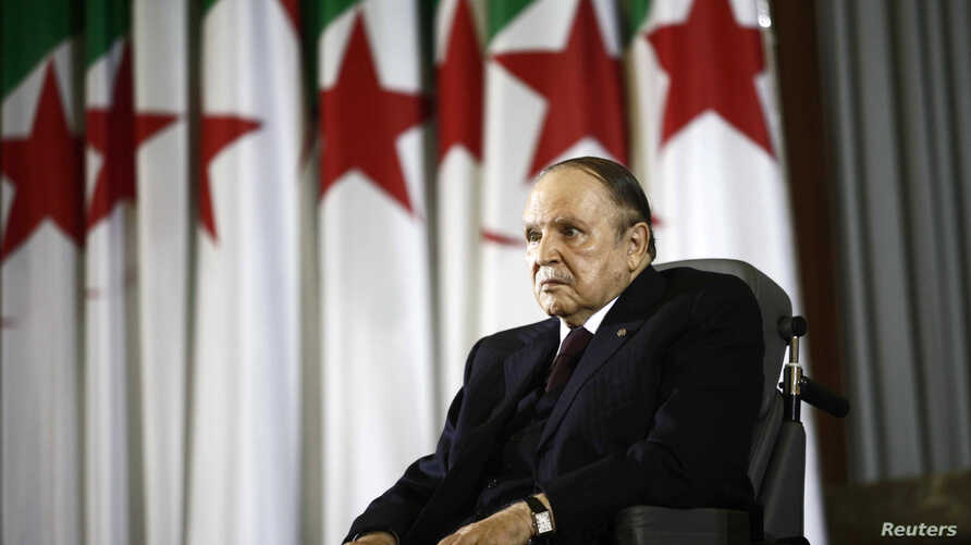 FILE - President Abdelaziz Bouteflika looks on during a swearing-in ceremony in Algiers, Algeria. The troops killed Saturday had taken part in a nationwide security operation for the controversial election that gave Bouteflika a fourth term.