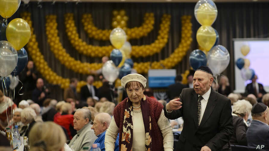 Two holocaust survivors arrive for the International Holocaust Survivors Night of the Jewish Community in Berlin, Germany, Tuesday, Dec. 4, 2018.