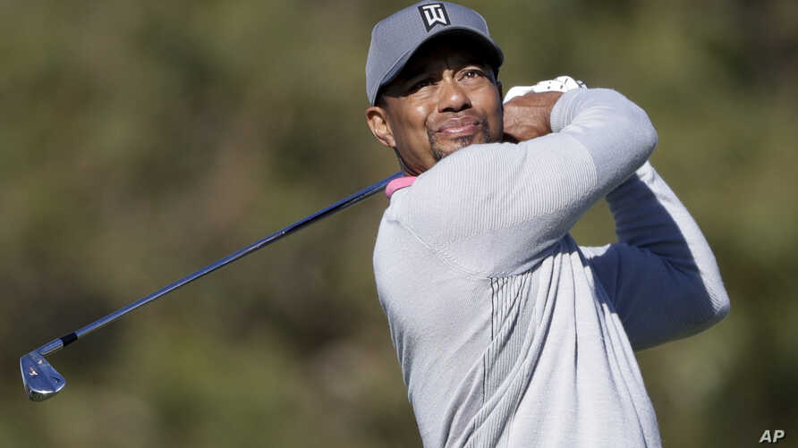 Tiger Woods watches his tee shot on the ninth hole of the North Course during the second round of the Farmers Insurance Open golf tournament, Jan. 27, 2017, at Torrey Pines Golf Course in San Diego.