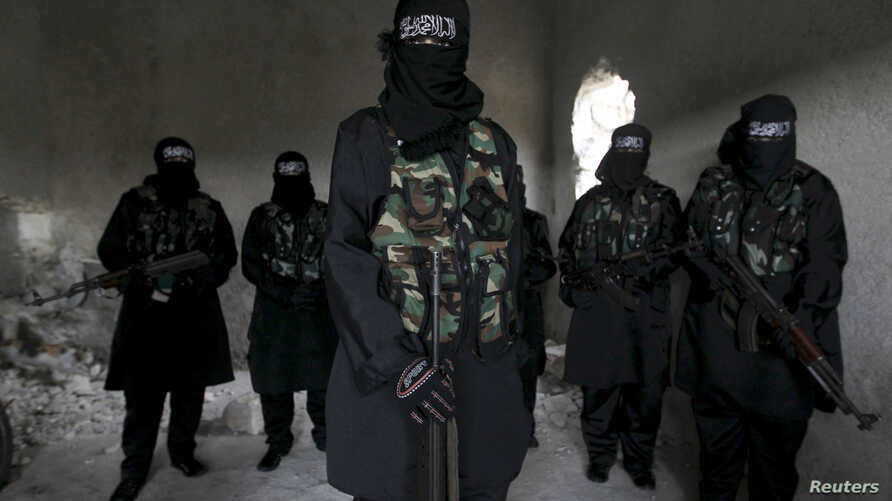 FILE - Women rebel fighters are seen undergoing military training in Aleppo, Syria, February 17, 2013.
