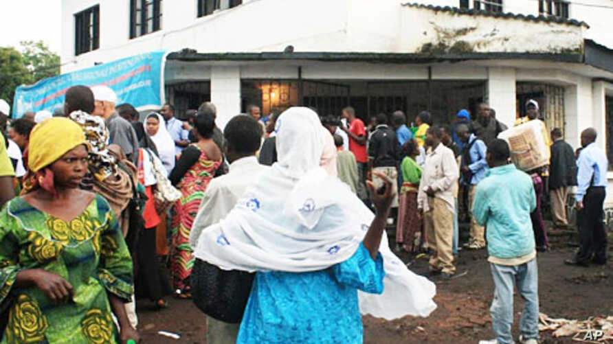 Outside the election board in North Kivu capital, Goma, crowds wait for hours for replacement cards, November 25, 2011.