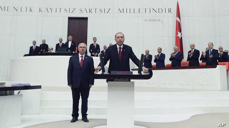 Turkey's President Recep Tayyip Erdogan takes the oath of office for his second term as president, at the parliament in Ankara, July 9, 2018.