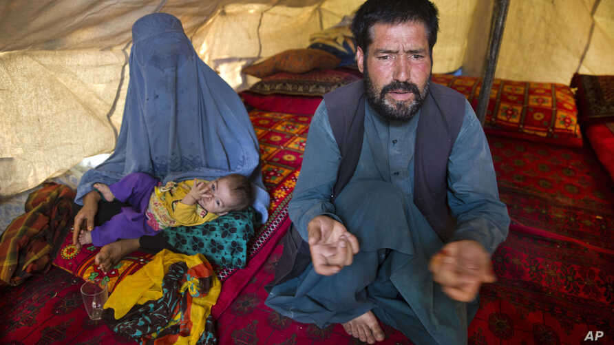 FILE - Mohammad Azam, whose pregnant teenage daughter Zarah died after being set on fire in her husband's home, speaks about her death in an interview in Kabul, Afghanistan, July 18, 2016. He traveled to the capital to call for justice in her killing