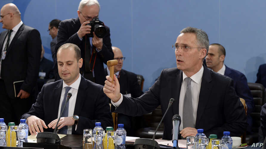 FILE - NATO Secretary General Jens Stoltenberg (R) and Georgia's Foreign Affairs Minister Mikheil Janelidze (L) attend a NATO Foreign Affairs Ministers' meeting held at NATO headquarter in Brussels on Dec. 6, 2017.