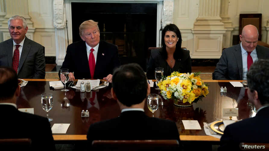 U.S. President Donald Trump, seated with Secretary of State Rex Tillerson, U.S. Ambassador to the United Nations Nikki Haley and U.S. National Security Adviser H.R. McMaster, plays host to a lunch for ambassadors to the United Nations Security Counci