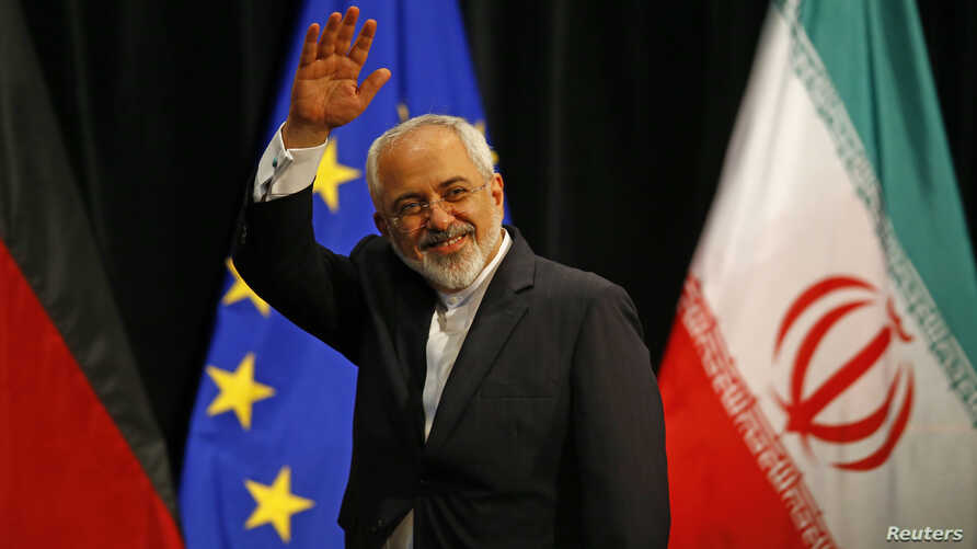FILE - Iranian Foreign Minister Mohammad Javad Zarif waves after a plenary session at the United Nations building in Vienna.