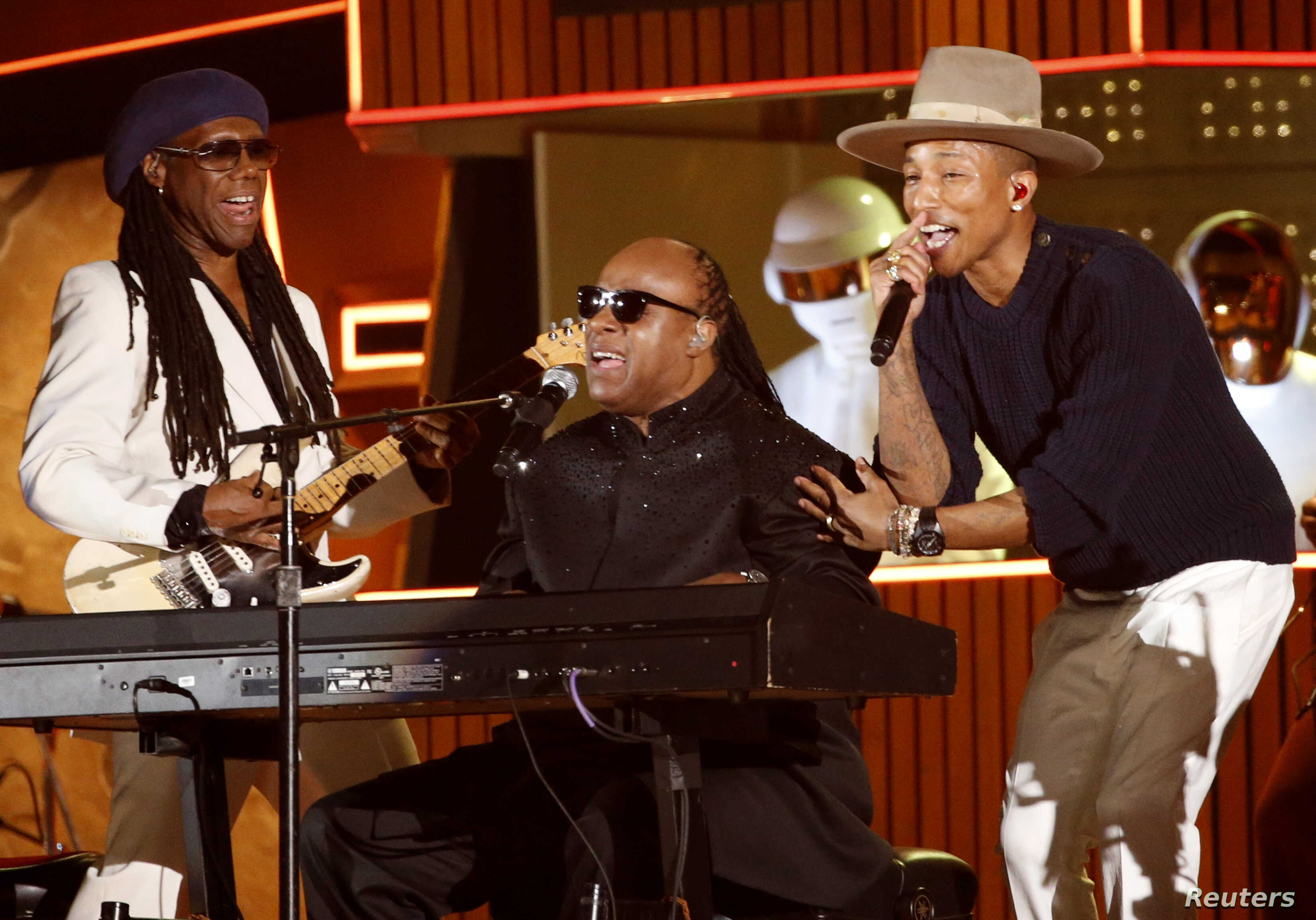 "Stevie Wonder (C) performs the Daft Punk's song ""Get Lucky"" with Pharrell Williams and Nile Rodgers (L) at the 56th annual Grammy Awards in Los Angeles, Jan. 26, 2014"