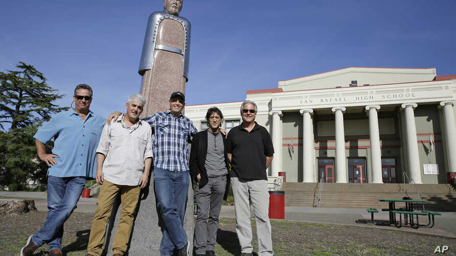 the Waldos, from left, Mark Gravitch, Larry Schwartz, Dave Reddix, Steve Capper and Jeffrey Noel pose below a statue of Louis Pasteur at San Rafael High School in San Rafael, California, April 13, 2018. Friday is April 20, or 4/20. That's the numeric
