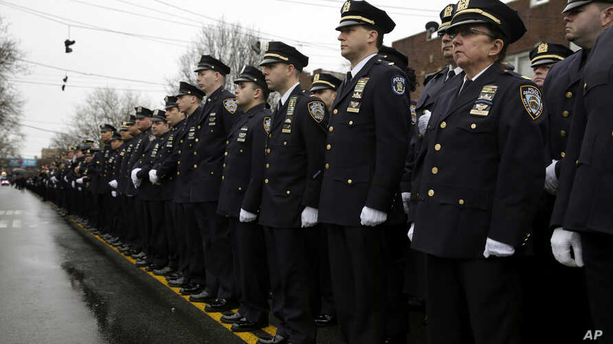 Police officers line the streets before the funeral of Officer Wenjian Liu in the Brooklyn borough of New York, Jan. 4, 2015.